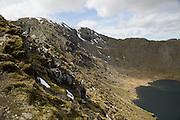 Helvellyn mountain peak and Red Tarn corrie lake, Lake District, Cumbria, England, UK