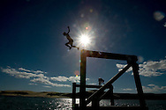 12-year-old Levi Parsons jumps of the Opononi wharf into the Hokianga Harbour, New Zealand. November 2005.<br /> Photograph Richard Robinson.<br /> 2005 &copy; New Zealand Herald A Division of APN New Zealand Ltd.<br /> No Reproduction without prior written permission. Contact www.newspix.co.nz to licence photograph.