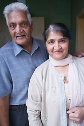 Older couple smiling at home,