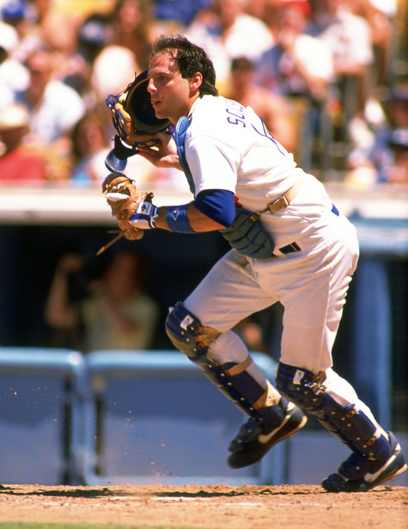 LOS ANGELES - 1989:  Mike Scoscia of the Los Angeles Dodgers catches during an MLB game at Dodger Stadium in Los Angeles, California during the 1989 season.  (Photo by Ron Vesely).  Subject:   Mike Scoscia