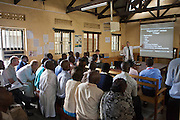 Staff at the Bwindi Community Hospital receive training from Dr Dan del Porto, a visiting doctor from the United States of America.  The hospital is in Buhoma village on the edge of the Bwindi Impenetrable Forest in Western Uganda. It serves around 250 000 people from the surrounding area.