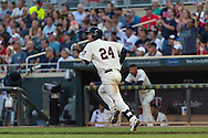 Trevor Plouffe #24 of the Minnesota Twins runs to 1st base after hitting a sacrifice fly against the Detroit Tigers on June 15, 2013 at Target Field in Minneapolis, Minnesota.  The Twins defeated the Tigers 6 to 3.  Photo: Ben Krause