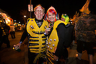 """Feb 15,  New Orleans, LA, People dressed as mutant fish take  part in the Krewe du Vieux Mardi Gras parade that roles through New Orleans Marigny and French Quarter.he 2014  theme was """"Where the Vile Things Are,"""".  Krewe du Vieux is know for it  raucous irreverent satire displayed on the floats and by the Krewe members."""