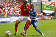 Tjaronn Chery gets a bit hands on during the Sky Bet Championship match between Charlton Athletic and Queens Park Rangers at The Valley, London, England on 8 August 2015. Photo by Andy Walter.