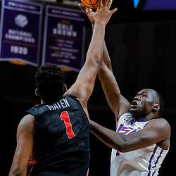 Jan 16, 2018; Baton Rouge, LA, USA; LSU Tigers forward Duop Reath (1) shoots over Georgia Bulldogs forward Yante Maten (1) during the second half at the Pete Maravich Assembly Center. Georgia defeated LSU 61-60. Mandatory Credit: Derick E. Hingle-USA TODAY Sports