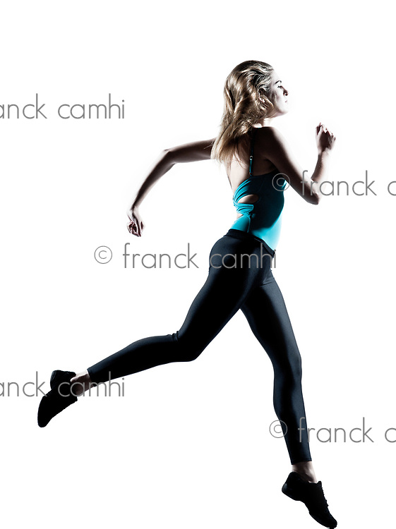 Beautiful attractive young woman running on white background