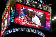 "U.S. President Barack Obama and first lady Michelle Obama are shown kissing on the ""Kiss Cam"" screen during a time out in an Olympic basketball exhibition game between the U.S. and Brazil national men's teams in Washington. They had been booed playfully by fans for not kissing earlier in the evening."