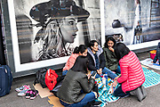 Filipino domestic workers gather on their day-off in front of fashion advertisements in Central District, Hong Kong. Approximately 130,000 Filipino domestic servants work in Hong Kong and all have Sundays off.