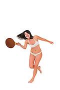 Young woman in a bikini plays racquetball