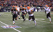 Cleveland Browns inside linebacker Craig Robertson (53) is chased by Cincinnati Bengals running back Jeremy Hill (32) and Cincinnati Bengals tight end Jermaine Gresham (84) after intercepting a first quarter pass and returning it to the Bengals 18 yard line during the NFL week 10 regular season football game against the Cleveland Browns on Thursday, Nov. 6, 2014 in Cincinnati. The Browns won the game 24-3. ©Paul Anthony Spinelli