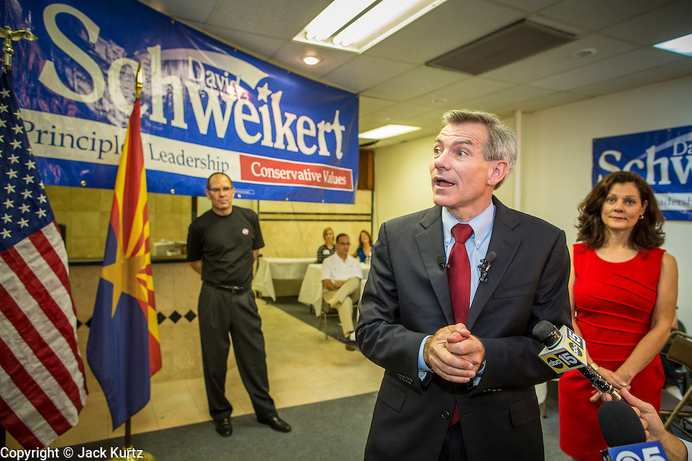28 AUGUST 2012 - PHOENIX, AZ:  Rep. DAVID SCHWEIKERT (R-AZ) makes his victory speech at his campaign office in Phoenix Tuesday night. Schweikert faced Congressman Ben Quayle in what was the hardest Republican primary election in Arizona in 2012. Both were incumbent Republican freshmen elected to Congress from neighboring districts in 2010. They ended up in the same district at the end of the redistricting process and faced off against each other in the primary to represent Arizona's 6th Congressional District, which is made up of Scottsdale, Paradise Valley and parts of Phoenix. The district is solidly Republican and the winner of the primary is widely expected to win November's general election. Both are conservative Republicans with Tea Party backing.   PHOTO BY JACK KURTZ