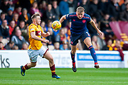 Jimmy Dunne (#3) of Heart of Midlothian heads the ball clear of Allan Campbell (#8) of Motherwell FC during the Ladbrokes Scottish Premiership match between Motherwell and Heart of Midlothian at Fir Park, Motherwell, Scotland on 15 September 2018.