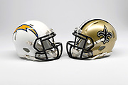 Detailed view of Los Angeles Chargers and New Orleans Saints helmets.