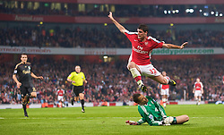 LONDON, ENGLAND - Wednesday, October 28, 2009: Liverpool's goalkeeper Diego Cavalieri and Arsenal's Fran Merida during the League Cup 4th Round match at Emirates Stadium. (Photo by David Rawcliffe/Propaganda)