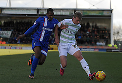 Yeovil Town's Stephen Kingsley is tackled by Gillingham's Gavin Hoyte  - Photo mandatory by-line: Harry Trump/JMP - Mobile: 07966 386802 - 21/02/15 - SPORT - Football - Sky Bet League One - Yeovil Town v Gillingham - Huish Park, Yeovil, England.