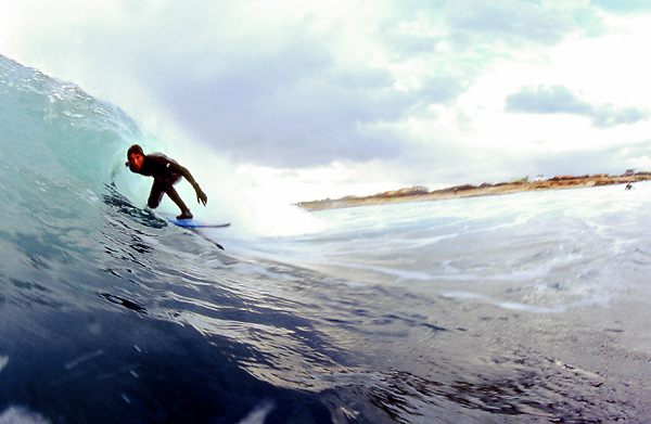 Clinco, one of the italian surfer sponsored by Quicksilver, surfs a wave in Sardegna. Spring swell, La Punta spot.