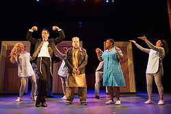 """© Licensed to London News Pictures. 08/10/2014. London, England. At left, Steven Serlin as Rabbi with Kev Orkian as Mahmoud and cast. The Musical """"The Infidel"""", based on the same named film by David Baddiel,  premieres at the Theatre Royal Stratford East, London. Directed by David Baddiel and Kerry Michael, book and lyrics by David Baddiel with music by Erran Baron Cohen. The Infidel is a story about Muslim man Mahmoud (Kev Orkian) who discovered that he is not only adopted but also Jewish. Photo credit: Bettina Strenske/LNP"""