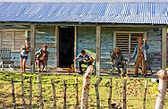 Family having dinner on their porch in the Puerto Prieta area, Pinar del Rio, Cuba.