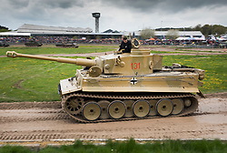 © Licensed to London News Pictures. 28/04/2018. Dorset, UK. German WWII battle tank 'Tiger 131' is driven round the arena at Bovington Tank Museum on the 75th anniversary of it's capture. Tiger 131, the only running Tiger I in the world was the first example of the fearsome new German fighting machine to be captured by the allies when it was captured during fierce fighting in the Tunisian desert in 1943. Photo credit: Peter Macdiarmid/LNP