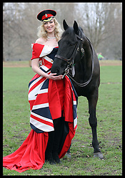 Model Jade Parfitt  in a red crinoline dress and Union Jack corset by designer Corrie Nielsen with George from the Household Cavalry Mounted Regiment during a photocall to launch the Fashion for the Brave fundraising event in London, Sunday 11th March 2012.   Photo by: Stephen Lock / i-Images