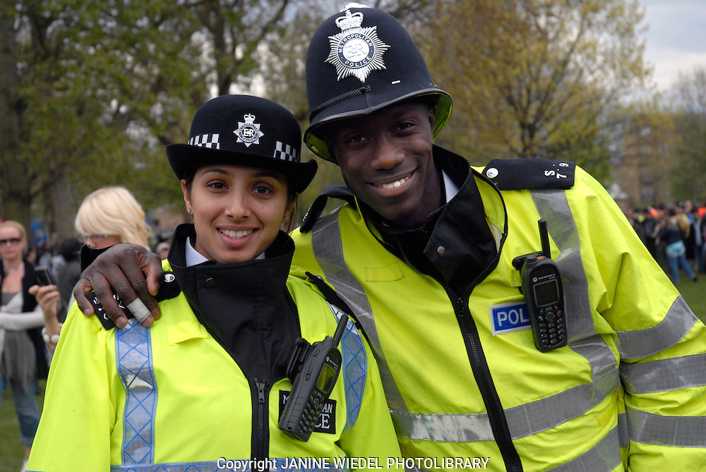 Policeman and woman of different ethnic race.