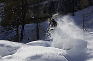 Male Snowboarder airs through the powder, Serre Chevalier, France
