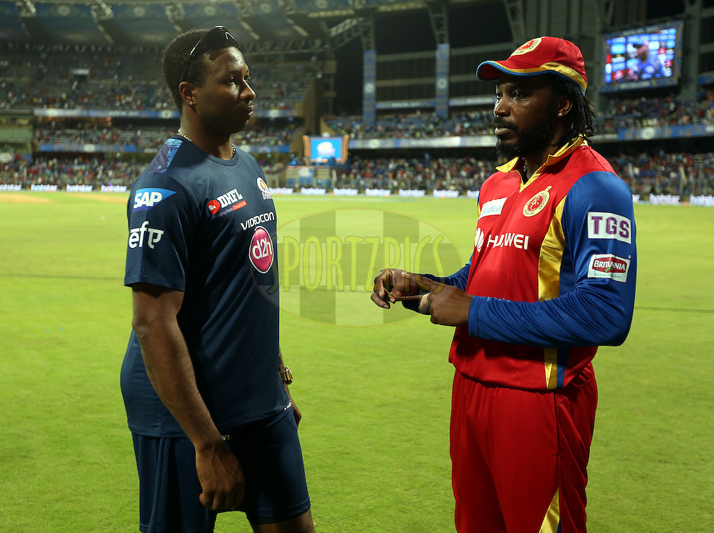 Mumbai Indians player Kieron Pollard and Royal Challengers Bangalore player Chris Gayle after the match 46 of the Pepsi IPL 2015 (Indian Premier League) between The Mumbai Indians and The Royal Challengers Bangalore held at the Wankhede Stadium in Mumbai, India on the 10th May 2015.<br /> <br /> Photo by:  Sandeep Shetty / SPORTZPICS / IPL