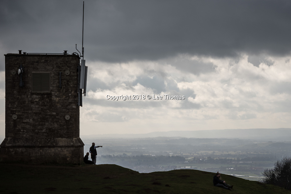 Bredon Hill, Worcestershire, UK. 17th February 2018. Walkers brave the cold and windy conditions on top of an atmospheric Bredon Hill in Worcestershire. // Lee Thomas, Tel. 07784142973. Email: leepthomas@gmail.com  www.leept.co.uk (0000635435)