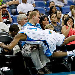 April 15, 2012; New Orleans, LA, USA; New Orleans Hornets point guard Jerome Dyson (11) dives into fans sitting courtside after saving a loose ball during the second half of a game against the Memphis Grizzlies at the New Orleans Arena. The Hornets defeated the Grizzlies 88-75.  Mandatory Credit: Derick E. Hingle-US PRESSWIRE