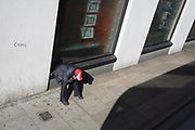 A person wearing an England cap looks down at the ground in Camberwell, on 26th September 2018, in Southwark, London, England.