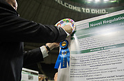 Ohio University President Duane Nellis hangs a 1st place ribbon during the 2018 Student Research Expo.