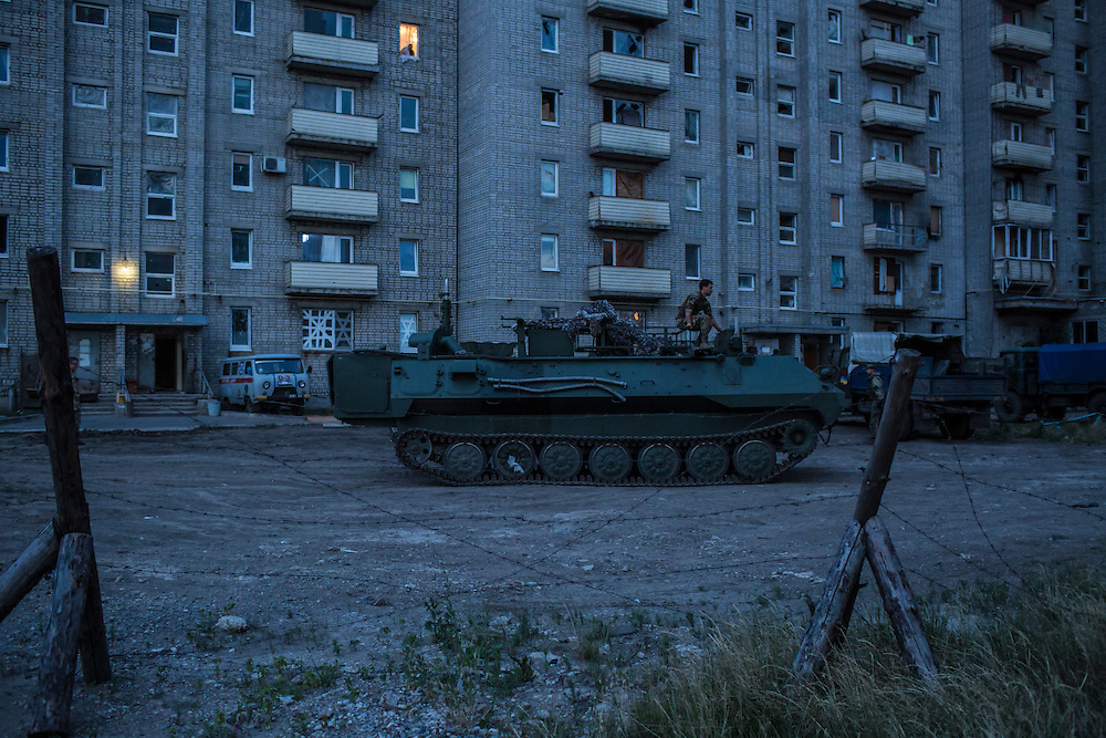 AVDIIVKA, UKRAINE - JULY 9, 2016: Ukrainian soldiers drive an MT-LBu personnel carrier in Avdiivka, Ukraine. The town is now one of the most active areas of fighting along the line of control between the Ukrainian government and Russian-backed rebels. CREDIT: Brendan Hoffman for The New York Times