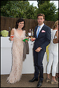 EVA LANSKA; DAVID GIGAURI, 2014 Serpentine's summer party sponsored by Brioni.with a pavilion designed this year by Chilean architect Smiljan Radic  Kensington Gdns. London. 1July 2014