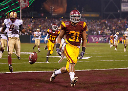 Dec 26, 2009; San Francisco, CA, USA;  Southern California Trojans fullback Stanley Havili (31) scores a touchdown against the Boston College Eagles during the first quarter of the 2009 Emerald Bowl at AT&T Park.  USC defeated BC 24-13.