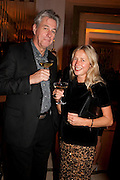 DR. RICHARD NOBLE; IWONA BLAZWICK, Harper's Bazaar Women Of the Year Awards 2011. Claridges. Brook St. London. 8 November 2011. <br /> <br />  , -DO NOT ARCHIVE-© Copyright Photograph by Dafydd Jones. 248 Clapham Rd. London SW9 0PZ. Tel 0207 820 0771. www.dafjones.com.