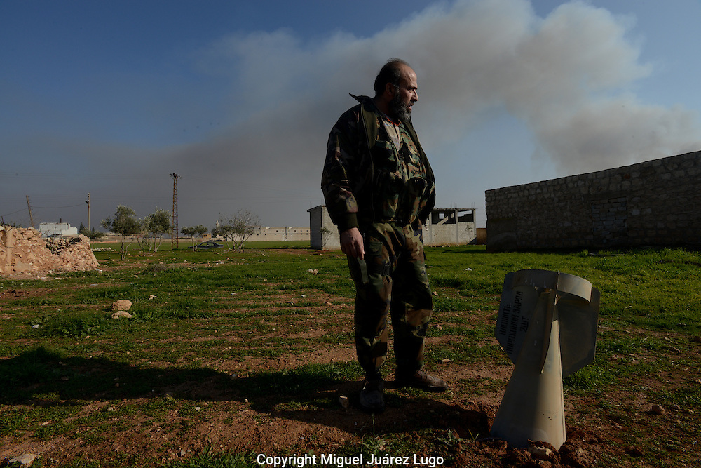 Aleppo, Syria, January 2013.- Former national Syrian champion bodybuilder ABU-ZOUBER, now a co-captain of the Baslaier Al-Nasr unit of the Free Syrian Army, finds an unexploded, Russian-made bomb dropped by the Syrian Army. (Photo by Miguel Juárez Lugo)