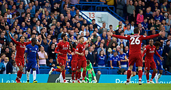 LONDON, ENGLAND - Saturday, September 29, 2018: Liverpool's Virgil van Dijk, Joe Gomez and Roberto Firmino appeal for a corner after an incorrect decision by the referee during the FA Premier League match between Chelsea FC and Liverpool FC at Stamford Bridge. (Pic by David Rawcliffe/Propaganda)