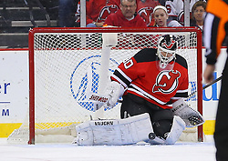 Mar 27, 2014; Newark, NJ, USA; New Jersey Devils goalie Martin Brodeur (30) makes a save during the first period of their game against the Phoenix Coyotes at Prudential Center.
