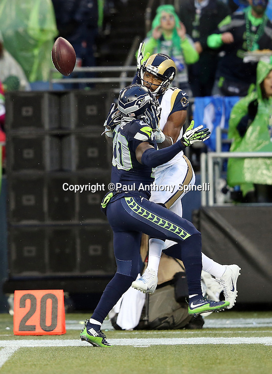 Seattle Seahawks cornerback Jeremy Lane (20) breaks up a deep pass intended for St. Louis Rams wide receiver Kenny Britt (18) during the 2015 NFL week 16 regular season football game against the St. Louis Rams on Sunday, Dec. 27, 2015 in Seattle. The Rams won the game 23-17. (©Paul Anthony Spinelli)