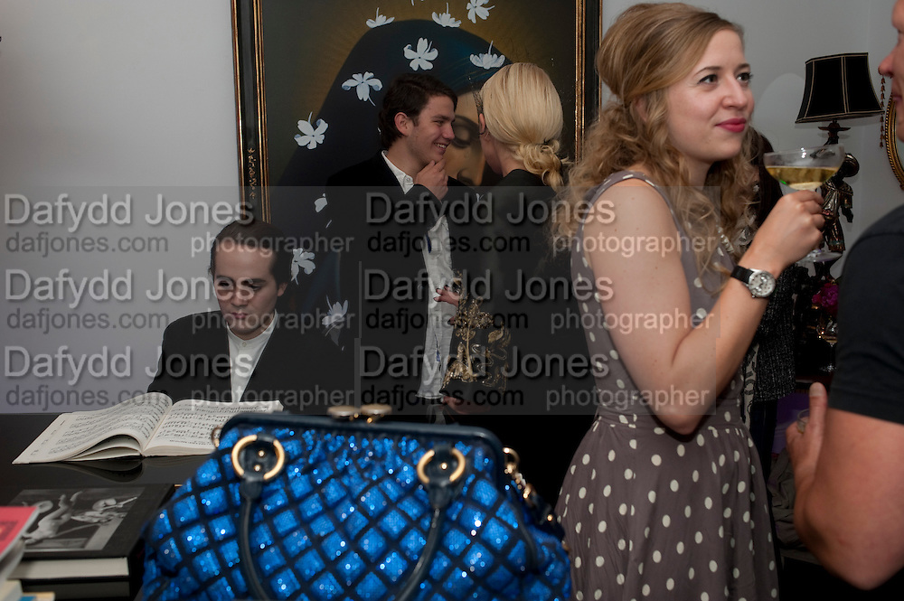 CHARLES ELLIASCH; ALEXANDER EVERINGTON; AMANDA ELIASCH; SUSAN PARKES, , Party at the home of Amanda Eliasch in Chelsea after the opening of As I Like it. A memory by Amanda Eliasch and Lyall Watson. Chelsea Theatre. Worl's End. London. 4 July 2010<br /> <br />  , -DO NOT ARCHIVE-© Copyright Photograph by Dafydd Jones. 248 Clapham Rd. London SW9 0PZ. Tel 0207 820 0771. www.dafjones.com.