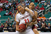 Virginia Cavaliers forward Jazmin Pitts (21) battles Boston College Eagles guard Kat Cooper (44) for the rebound during the 1st round of the 2012 ACC Women's Basketball Tournament in Greensboro, North Carolina.  Virginia won 72 - 41.  March 01, 2012  (Photo by Mark W. Sutton)