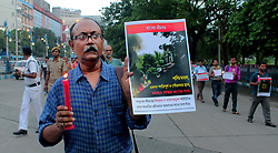 July 8, 2017 - Kolkata, West Bengal, India - Syachetan nagorik mancha supporters take a part in candle light rally at kolkata against recent  communal violence at baduria of North 24 Parganas in West Bengal on July 08, 2017..Syachetan nagorik mancha supporters take a part in candle light rally at kolkata against recent  communal violence at baduria of North 24 Parganas in West Bengal on July 08, 2017 (Credit Image: © Sanjay Purkait/Pacific Press via ZUMA Wire)