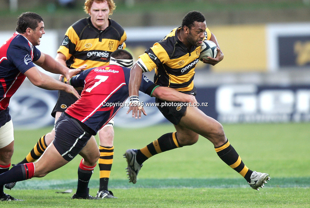 Tomasi Soqeta of Taranaki gets tackled by Jonathan Poff of Tasman during the Air NZ Cup rugby match between Taranaki and Tasman at Yarrow Stadium, New Plymouth, New Zealand on Saturday 30 September, 2006. Photo: Marty Melville/PHOTOSPORT