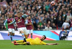 Aston Villa's Ashley Westwood tackles Liverpool's Emre Can - Photo mandatory by-line: Alex James/JMP - Mobile: 07966 386802 - 19/04/2015 - SPORT - Football - London - Wembley Stadium - Aston Villa v Liverpool - FA Cup Semi-Final