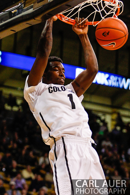 November 16th, 2013:  Colorado Buffaloes redshirt freshman forward Wesley Gordon (1) elevates for a dunk in the second half of the NCAA Basketball game between the Jackson State Tigers and the University of Colorado Buffaloes at the Coors Events Center in Boulder, Colorado