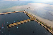 Nederland, Zeeland, Oosterschelde, 22-05-2011; De voormalige werkhavens bij werkeiland Neeltje Jans, gebruikt voor de bouw van de Oosterscheldekering. Havens nu in gebruik voor kweek van mosselen en oesters. Drijvende hangcultuur. .The former work harbors near island Neeltje Jans, used for the construction of the Oosterschelde barrier. Ports now in use for cultivation of mussels and oysters. Floating suspension culture for mussel farming..luchtfoto (toeslag); aerial photo (additional fee required);.foto Siebe Swart / photo Siebe Swart