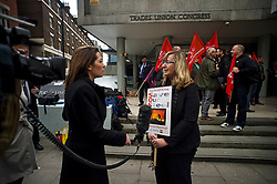 © Licensed to London News Pictures. 04/04/2016. London, UK. A woman holding a banner as she is interviews by a news television outside Congress House in London where TATA steel workers are due to hold a meeting, organised by the Trade Union Congress (TUC), to discuss the future of Port Talbot TATA steel works. Photo credit: Ben Cawthra/LNP