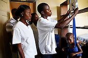 Serge Laba, the senior paediatric nurse in Masi Manimba hospital, in DRC's Bandundu Province, checks the weight of a malnourished child.<br /> <br /> &quot;Before Action Against Hunger came here, we used to see lots of malnutrition cases. Now we don't see so many.&quot;<br /> <br /> Acute malnutrition is a major public health problem across the Democratic Republic of Congo. UK aid has supported the government of DRC and aid agencies including Action Against Hunger to provide emergency nutrition response programmes across DRC in 2010 and 2011. <br /> <br /> In some areas, the communities have taken the ideas that Action Against Hunger brought to them, and organised themselves to tackle malnutrition from the ground up - by forming their own co-operative farms and self-support groups.