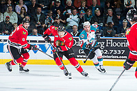 KELOWNA, CANADA - APRIL 14: Caleb Jones #3 of the Portland Winterhawks breaks away with the puck with Reid Gardiner #23 of the Kelowna Rockets in pursuit on April 14, 2017 at Prospera Place in Kelowna, British Columbia, Canada.  (Photo by Marissa Baecker/Shoot the Breeze)  *** Local Caption ***
