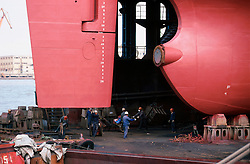CHINA SHANGHAI NOV01 - Shipyard workers on the floating dry dock under the rudder of a large ocean-going vessel.. . jre/Photo by Jiri Rezac. . © Jiri Rezac 2001. . Contact: +44 (0) 7050 110 417. Mobile:  +44 (0) 7801 337 683. Office:  +44 (0) 20 8968 9635. . Email:   jiri@jirirezac.com. Web:     www.jirirezac.com
